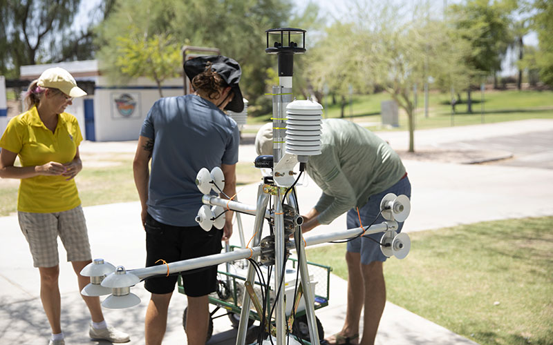The MaRTy team gets the unit ready to record data in a Tempe park. Data will help them understand what types of trees and structures provide the best shade from the sun.  (Photo by Dylan Simard/ Cronkite News)